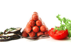 Pyramide of sauages with vegetables stock images