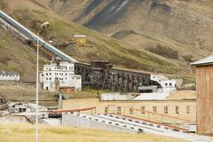 View to the ruined coal mine in the abandoned Russian arctic settlement Pyramiden, Norway. stock image