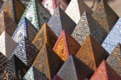 Pyramids. Egypt souvenirs, multicolored pyramids with egyptian hieroglyphs Royalty Free Stock Photo