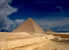 Pyramids. A view across an open desert to ancient pyramids in the distance Stock Image