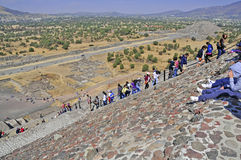 Pyramids on Avenue of the Dead, Teotihuacan, Mexico. Teotihuacan, Mexico – circa December 2012. Tourists flock to see the Pyramids of Teotihuacan, one of the Stock Photo
