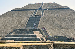 Pyramids on Avenue of the Dead, Teotihuacan, Mexico. Teotihuacan, Mexico – circa December 2012. Tourists flock to see the Pyramids of Teotihuacan, one of the Stock Photography