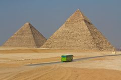 Pyramids of Egypt. Bus on the background of the Egyptian pyramids Royalty Free Stock Images