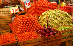 Pyramids of fresh tomatoes, indoor market, stock photography