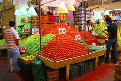 Pyramids of fresh tomatoes, indoor market, Royalty Free Stock Photos