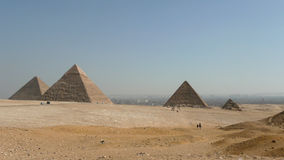 Pyramids of Giza. In the morning with Cairo background Stock Photos