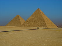 The Pyramids at Giza on a blue sky day. This photograph is of The Pyramids at Giza on a lovely blue sky day in December Stock Photos