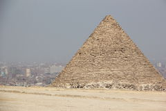 The Pyramids of Giza, Cairo, Egypt. The Giza Necropolis is an archaeological site on the Giza Plateau, on the outskirts of Cairo, Egypt. This complex of ancient Royalty Free Stock Images