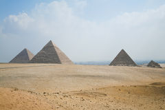 Pyramids of Giza at Cairo Egypt horizontal. Landmark of three pyramids in Giza next to Cairo city Egypt, Africa, the Great Pyramid of Khufu, from year 2500 Stock Images