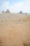 Pyramids of Giza at Cairo Egypt vertical. Landmark of three pyramids in Giza next to Cairo city Egypt, Africa, the Great Pyramid of Khufu, from year 2500 Before Royalty Free Stock Image
