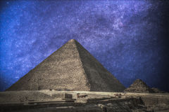 Pyramids in Giza. Complex of ancient buildings in Egypt. Astrophotography. Night sky with stars stock images
