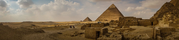 Pyramids of Giza, Egypt. Panoramic shot of The Great Pyramids in Giza, Egypt Royalty Free Stock Images