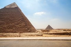 Pyramids of Giza in Egypt - Two pyramids in Cairo on blue sky background stock image