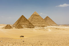 The Pyramids of Giza. The Pyramids plateau is dominated by the massive pyramids of Khufu (Cheops), Khafre (Chephren), and Menkaure (Mycerinus), all of whom ruled Stock Image