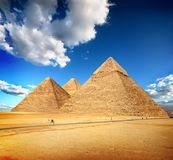 Pyramids of Giza. In the desert by day Royalty Free Stock Photo