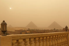 Pyramids in Giza at sandy storm. View on pyramids in Giza at sandy storm Stock Photo