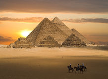 Pyramids of Gizeh Fantasy. The Pyramids of Gizeh near Cairo in Egypt during a golden sunset