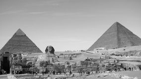 Pyramids of Khafre and Khufu and the Great Sphinx of Giza. Egypt, in monochrome Royalty Free Stock Images