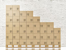 Pyramids Made of Plastic Blocks Isolated on White Cardbord boxes on wooden pallete in front of white brick wall Stock Photography