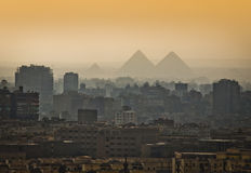 Pyramids in the mist. Pyramids in the mist, Cairo, Egypt. Largest city in Africa Royalty Free Stock Image