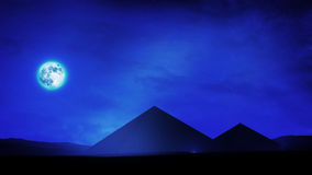 Pyramids At Night. With full moon and the stars in the sky with wispy cirrus clouds Stock Image