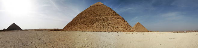 Pyramids panoramic. Panoramic view of Great pyramids of Giza Royalty Free Stock Image