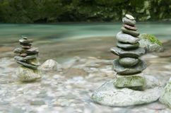Stack of stones near water stream in Soca valley, Slovenia Stock Image