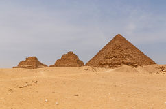 Pyramids of Queens in front of pyramid of Menkaure. In Giza, Egypt Stock Photography