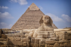 Pyramids and sphinx in Egypt. Image of the Sphinx monument by the great pyramids in Cairo, Egypt Royalty Free Stock Image