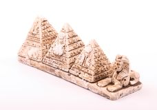 Pyramids and sphinx statuette. Statuette of pyramids and the Sphinx as a souvenir from Giza on white background Stock Photo