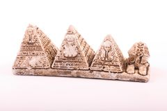 Pyramids and sphinx statuette. Statuette of pyramids and the Sphinx as a souvenir on white background Royalty Free Stock Photo