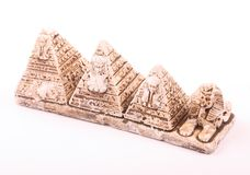 Pyramids and sphinx statuette. Statuette of pyramids and the Sphinx as a souvenir on white background Stock Photos