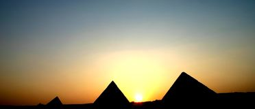 Pyramids sunset. Egypt:keops , kefren and micerinos pyramids sunset Royalty Free Stock Images