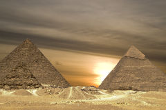 Pyramids sunset Drama. Dramatic sunset behind the Egyptian Pyramids royalty free stock photography