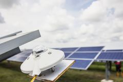 Pyranometer for measuring irradiance in solar farm with blue sky Royalty Free Stock Photography