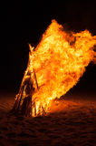 Pyre burning on the beach Royalty Free Stock Image