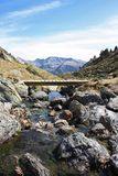 Pyrenees. Spectacular landscape with river and wooden bridge in the Andorran Pyrenees royalty free stock images