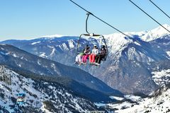 PYRENEES, ANDORRA - FEBRUARY 9, 2017: Skiers On The Chair Lift O Stock Images