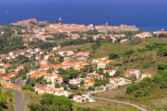 Pyrenees Orientales Vermilion coast landscape, vineyards fields with the village of Collioure. And the Mediterranean sea, south of France, Roussillon Stock Photos