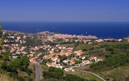 Pyrenees Orientales Vermilion coast landscape, vineyards fields with the village of Collioure. And the Mediterranean sea, south of France, Roussillon Stock Photography