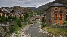 Pyrenees village of Catalonia, with moving clouds and sunlight.  Time Lapse stock video