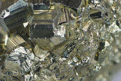Pyrite. Background of an iron pyrite mineral Royalty Free Stock Photo