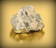 Pyrite. A close up of iron pyrite mineral on yellow background Stock Photos