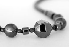 Pyrite Bead Necklace. Black and white, close-up photograph of a pyrite bead necklace Stock Images