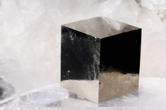 Pyrite cube crystal. On quartz background Stock Photos