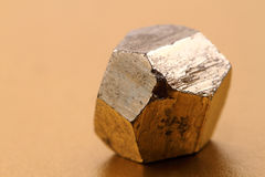 Pyrite cubes. On the golden background Stock Image