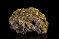 Pyrite in front of black Background Stock Images