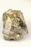 Pyrite mineral. Stone of pyrite mineral similar to gold on a white backgound Stock Image