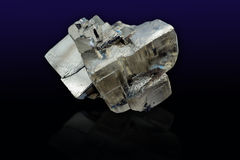 Pyrite mineral closeup. Pyrite mineral close up on black background Stock Images