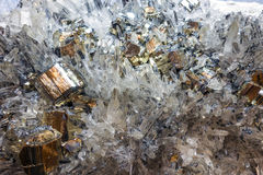 Pyrite and other crystals illuminated with monocromatic light Royalty Free Stock Image